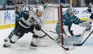 Los Angeles Kings center Trevor Moore (12) skates toward San Jose Sharks goaltender Martin Jones (31) during the second period of an NHL hockey game in San Jose, Calif., Wednesday, March 24, 2021. (AP Photo/Jeff Chiu)