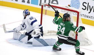 Dallas Stars left wing Roope Hintz (24) turns after scoring against Tampa Bay Lightning goaltender Andrei Vasilevskiy (88) during the third period of an NHL hockey game in Dallas, Thursday, March 25, 2021. (AP Photo/Michael Ainsworth)
