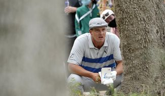 Bryson DeChambeau lines up a shot near the trees on the 16th hole during a first round match at the Dell Technologies Match Play Championship golf tournament Wednesday, March 24, 2021, in Austin, Texas. (AP Photo/David J. Phillip)