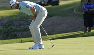 Dustin Johnson misses a birdie putt on the 18th green, tying the hole and the match with Robert MacIntyre of Scotland during a second round match at the Dell Technologies Match Play Championship golf tournament Thursday, March 25, 2021, in Austin, Texas. (AP Photo/David J. Phillip)