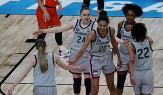 UConn players celebrate after a basket during the second half of a college basketball game against Syracuse in the second round of the women's NCAA tournament at the Alamodome in San Antonio, Tuesday, March 23, 2021. (AP Photo/Charlie Riedel) **FILE**