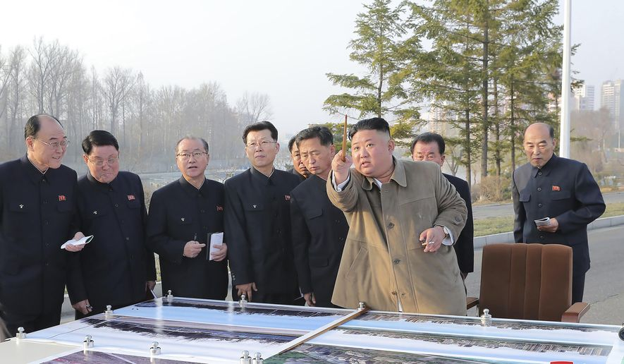 """In this undated photo provided by the North Korean government, North Korean leader Kim Jong Un, front right, visits the site of a planned area of riverside terraced houses in Pyongyang, North Korea. Independent journalists were not given access to cover the event depicted in this image distributed by the North Korean government. The content of this image is as provided and cannot be independently verified. Korean language watermark on image as provided by source reads: """"KCNA"""" which is the abbreviation for Korean Central News Agency. (Korean Central News Agency/Korea News Service via AP)"""