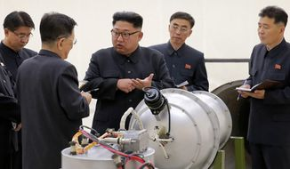 This undated file photo distributed by the North Korean government shows North Korean leader Kim Jong-un, center, at an undisclosed location in North Korea. (Korean Central News Agency/Korea News Service via AP, File)