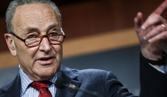 Senate Majority Leader Chuck Schumer of New York holds a news conference Thursday, March 25, 2021, on Capitol Hill in Washington. (Jonathan Ernst/Pool via AP) **FILE**