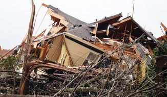 A house is totally destroyed after a tornado touches down south of Birmingham, Ala. in the Eagle Point community damaging multiple homes. Authorities reported major tornado damage Thursday south of Birmingham as strong storms moved through the state. The governor issued an emergency declaration as meteorologists warned that more twisters were likely on their way. (AP Photo/Butch Dill)