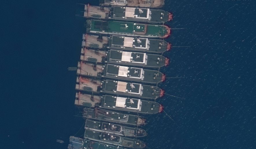 This satellite image provided by Maxar Technologies shows Chinese vessels anchored the Whitsun Reef located in the disputed South China Sea. Tuesday, March 23, 2021. The United States said Tuesday it's backing the Philippines in a new standoff with Beijing in the disputed South China Sea, where Manila has asked a Chinese fishing flotilla to leave a reef. China ignored the call, insisting it owns the offshore territory. (©2021 Maxar Technologies via AP)
