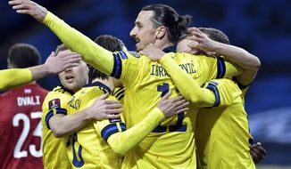 Sweden's Zlatan Ibrahimovic, center, celebrates scoring his side's first goal during World Cup 2022 qualifier group A soccer game between Sweden and Georgia at Friends Arena in Stockholm, Thursday March 25, 2021. (Pontus Lundahl/TT News Agency via AP)