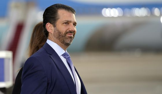 In this Jan. 20, 2021, photo, Donald Trump Jr. waits by Air Force One at Andrews Air Force Base, Md. (AP Photo/Manuel Balce Ceneta) **FILE**