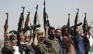 FILE - In this Aug. 22, 2020 file photo, tribesmen loyal to Houthi rebels raise their weapons during a protest against the agreement to establish diplomatic relations between Israel and the United Arab Emirates, in Sanaa, Yemen. Saudi Arabia announced a plan Monday, March 22, 2021, to offer Yemen's Houthi rebels a cease-fire in the country's yearslong war and allow a major airport to reopen in its capital, the kingdom's latest attempt to halt fighting that has sparked the world's worst humanitarian crisis in the Arab world's poorest nation. (AP Photo/Hani Mohammed, File)
