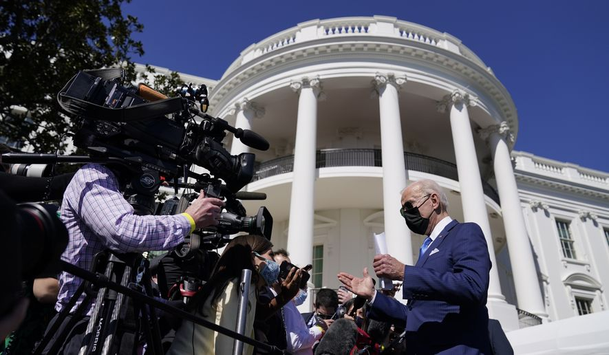 President Joe Biden talks to members of the media before walking to board Marine One on the South Lawn of the White House, Friday, March 26, 2021, in Washington. (AP Photo/Evan Vucci)