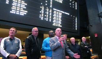 File-In this March 8, 2019 photo, Steve Callender, senior vice president at Eldorado Resorts, speaks at the dedication of a new sportsbook at the Tropicana casino in Atlantic City N.J. Eldorado has since merged with Caesars Entertainment, and on March 26, 2021, Callender announced his retirement. (AP Photo/Wayne Parry, File)