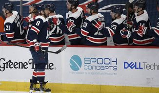 Washington Capitals left wing Alex Ovechkin (8) celebrates his goal with the bench during the first period of an NHL hockey game against the New Jersey Devils, Friday, March 26, 2021, in Washington. (AP Photo/Nick Wass)