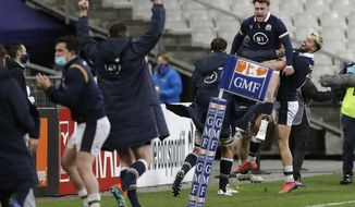 Scotland's Stuart Hogg, second right, celebrates after Scotland's Duhan Van der Merwe scored the winning try during the Six Nations rugby union international match between France and Scotland at the Stade de France in Saint-Denis, near Paris, Friday, March 26, 2021. (AP Photo/Christophe Ena)