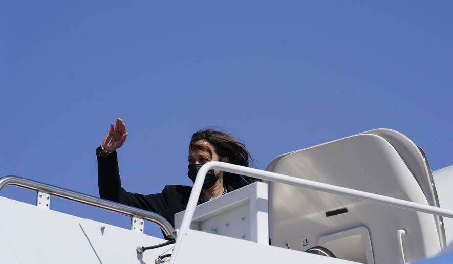 Vice President Kamala Harris waves before boarding Air Force Two at Andrews Air Force Base, Md., Friday, March 26, 2021. Harris is traveling to Connecticut to hold a listening session at the Boys & Girls Club of New Haven on how the American Rescue Plan addresses child poverty and education. (AP Photo/Susan Walsh)