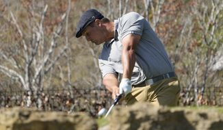 Bryson DeChambeau hits his tee shot on the No. 5 hole during a third round match at the Dell Technologies Match Play Championship golf tournament Friday, March 26, 2021, in Austin, Texas. (AP Photo/David J. Phillip)