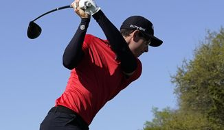 Dylan Frittelli, of South Africa, hits from the No. 3 tee during a third round match at the Dell Technologies Match Play Championship golf tournament Friday, March 26, 2021, in Austin, Texas. (AP Photo/David J. Phillip)