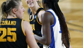 Iowa guard Caitlin Clark (22) smile at Kentucky guard Rhyne Howard (10) after she was fouled during the second half of a college basketball game in the second round of the women's NCAA tournament at the Greehey Arena in San Antonio, Tuesday, March 23, 2021. Iowa defeated Kentucky 86-72. (AP Photo/Ronald Cortes)