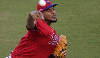 Philadelphia Phillies pitcher Ivan Nova delivers during the first inning of a spring training exhibition baseball game against the New York Yankees in Tampa, Fla., Friday, March 19, 2021. (AP Photo/Gene J. Puskar