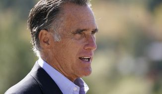 In this Oct. 15, 2020, file photo, Sen. Mitt Romney, R-Utah, speaks during a news conference near Neffs Canyon, in Salt Lake City. Romney was named the winner of the Profile in Courage Award on Friday, March 26, 2021, for splitting with his party and becoming the only Republican to vote to convict former President Donald Trump during his first impeachment trial. (AP Photo/Rick Bowmer, File)