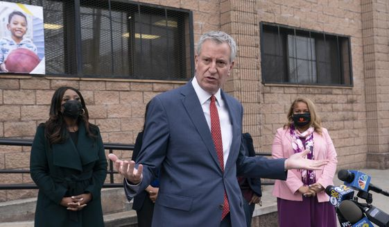 Mayor Bill de Blasio gives a news conference outside Phyl's Academy, Wednesday, March 24, 2021, in the Brooklyn borough of New York. (AP Photo/Mark Lennihan)
