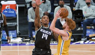 Sacramento Kings guard DaQuan Jeffries (19) defends against Golden State Warriors guard Nico Mannion (2) during the first quarter of an NBA basketball game in Sacramento, Calif., Thursday, March 25, 2021. (AP Photo/Randall Benton)