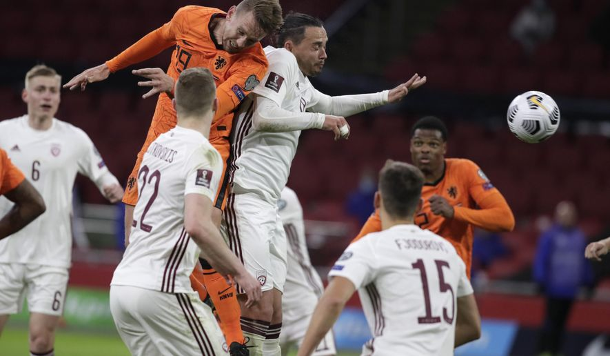 Netherlands' Luuk de Jong heads the ball to score his side's second goal during the World Cup 2022 group G qualifying soccer match between The Netherlands and Latvia at the Johan Cruyff ArenA in Amsterdam, Netherlands, Saturday, March 27, 2021. (AP Photo/Peter Dejong)
