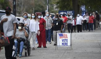 In this Oct. 12, 2020, file photo, people wait in line for early voting at the Bell Auditorium in Augusta, Ga. (Michael Holahan/The Augusta Chronicle via AP, File)  ** FILE **