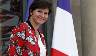 """French Sports Minister Roxana Maracineanu leaves the Elysee Palace after the weekly cabinet meeting, in Paris, Wednesday, Sept. 5, 2018. France's sports minister Maracineanu, says French society is at a """"turning point"""" for women's rights within the male-dominated sports world amid a wave of protests from female journalists denouncing discrimination. (AP Photo/Christophe Ena)"""