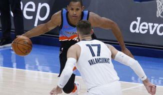 Oklahoma City Thunder center Al Horford (42) goes against Memphis Grizzlies center Jonas Valanciunas (17) during the second half of an NBA basketball game, Wednesday, March 24, 2021, in Oklahoma City. (AP Photo/Garett Fisbeck)