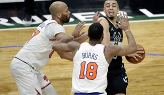 Milwaukee Bucks' Jordan Nwora drives to the basket against New York Knicks' Alec Burks (18) and Taj Gibson during the second half of an NBA basketball game Saturday, March 27, 2021, in Milwaukee. (AP Photo/Aaron Gash)