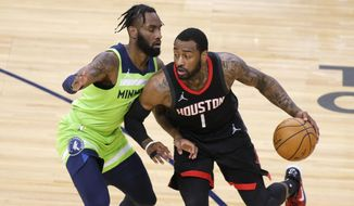 Houston Rockets guard John Wall (1) drives on Minnesota Timberwolves guard Jaylen Nowell (4) during the first half of an NBA basketball game Saturday, March 27, 2021, in Minneapolis. (AP Photo/Andy Clayton-King) **FILE**