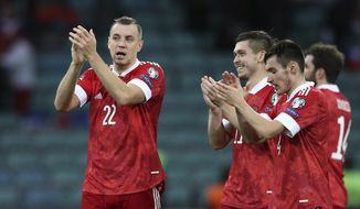 Russia's Artyom Dzyuba, left, reacts after the World Cup 2022 group H qualifying soccer match between Russia and Slovenia at the Fisht Olympic Stadium in Sochi, Russia, Saturday, March 27, 2021. (AP Photo/str)