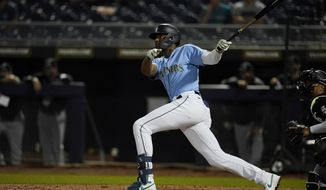 Seattle Mariners' Kyle Lewis watches his home run during the third inning of the team's spring training baseball game against the Chicago White Sox, Friday, March 19, 2021, in Peoria, Ariz. (AP Photo/Sue Ogrocki)