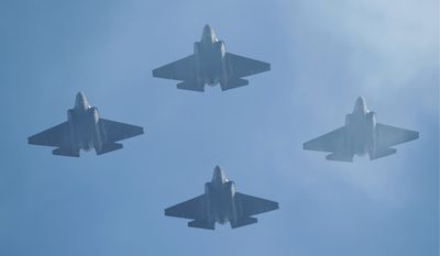 U.S. Navy F-35 jets fly over Levi's Stadium during the national anthem before an NFL divisional playoff football game between the San Francisco 49ers and the Minnesota Vikings, Saturday, Jan. 11, 2020, in Santa Clara, Calif. (AP Photo/Ben Margot)