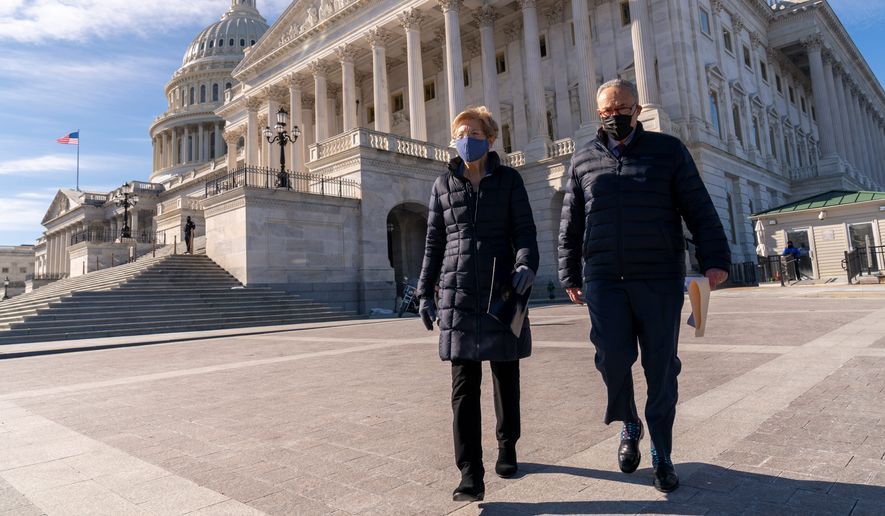 Senate Majority Leader Charles E. Schumer and Sen. Elizabeth Warren are pressuring President Biden to take executive action to cancel debt for federal student loan borrowers. (Associated Press)