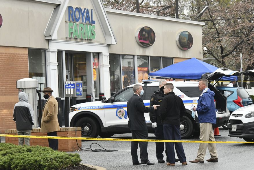 Baltimore County police investigate a shooting Sunday, March 28, 2021 at the Royal Farms in Essex, Md. Police say two people have been killed and a third person injured in a shooting at a Maryland convenience store and gas station. The Baltimore Sun reports that police in Baltimore County were investigating whether the deadly shooting Sunday at a Royal Farms stor was related to a fire and another fatal shooting 15 minutes later at a nearby apartment complex. (Amy Davis/The Baltimore Sun via AP)