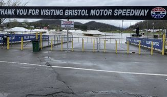 Water floods the vendor area as races for both the Truck Series and NASCAR Cup Series auto race were postponed due to inclement weather at Bristol Motor Speedway, Sunday, March 28, 2021, in Bristol, Tenn. (AP Photo/Jenna Fryer)