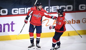 Washington Capitals right wing Tom Wilson (43) celebrates his second goal with center Nicklas Backstrom (19) during the second period of an NHL hockey game against the New York Rangers, Sunday, March 28, 2021, in Washington. (AP Photo/Nick Wass)