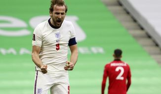 England's Harry Kane celebrates his side's first goal during the World Cup 2022 group I qualifying soccer match between Albania and England at Air Albania stadium in Tirana, Sunday, March 28, 2021. England won 2-0. (AP Photo/Hektor Pustina)