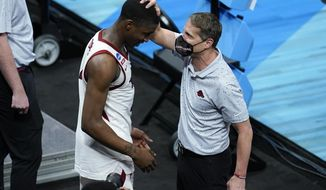 Arkansas head coach Eric Musselman, right, celebrates with guard Davonte Davis after a Sweet 16 game against Oral Roberts in the NCAA men's college basketball tournament at Bankers Life Fieldhouse, Saturday, March 27, 2021, in Indianapolis. Arkansas won 72-70. (AP Photo/Darron Cummings)