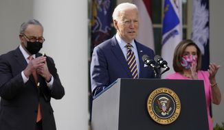 FILE - In this March 12, 2021, file photo President Joe Biden speaks about the American Rescue Plan, a coronavirus relief package, in the Rose Garden of the White House in Washington. Senate Majority Leader Chuck Schumer of N.Y., left, and House Speaker Nancy Pelosi of Calif., listen. (AP Photo/Alex Brandon, File)