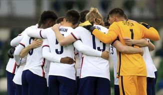 United States players prepare prior an international friendly soccer match between Northern Ireland and United States, at Windsor Park, Belfast, Northern Ireland, Sunday, March 28, 2021. (AP Photo/Peter Morrison)