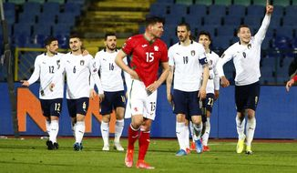 Italy's Andrea Belotti celebrates his first goal during the World Cup 2022 Group C qualifying soccer match between Bulgaria and Italy at Vassil Levski stadium, in Sofia, Sunday, March 28, 2021. (AP Photo/ Tony Uzunov)