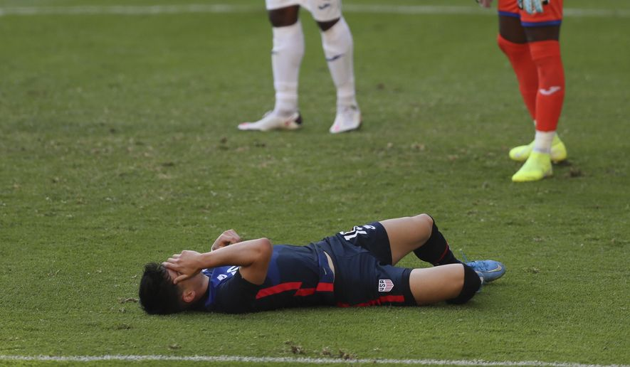 United States' Sebastian Soto grimaces in pain during a Concacaf Men's Olympic qualifying championship semi-final soccer match against Honduras in Guadalajara, Mexico, Sunday, March 28, 2021. (AP Photo/Fernando Llano)