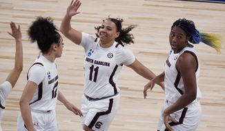 South Carolina guard Destiny Littleton (11) celebrates a score against Georgia Tech during the first half of a college basketball game in the Sweet Sixteen round of the women's NCAA tournament at the Alamodome in San Antonio, Sunday, March 28, 2021. (AP Photo/Eric Gay)