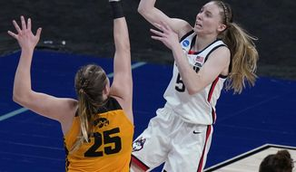 UConn guard Paige Bueckers (5) shoots over Iowa forward Monika Czinano (25) during the second half of a college basketball game in the Sweet Sixteen round of the women's NCAA tournament at the Alamodome in San Antonio, Saturday, March 27, 2021. (AP Photo/Eric Gay)