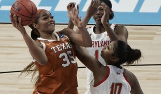 Texas's Charli Collier shoots over Maryland's Angel Reese during the second half of an NCAA college basketball game in the Sweet 16 round of the Women's NCAA tournament Sunday, March 28, 2021, at the Alamodome in San Antonio. (AP Photo/Morry Gash)