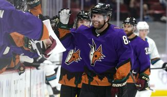 Arizona Coyotes right wing Phil Kessel (81) celebrates with teammates after scoring his third goal of the night against the San Jose Sharks, duirng the third period of an NHL hockey game Saturday, March 27, 2021, in Glendale, Ariz. (AP Photo/Rick Scuteri)