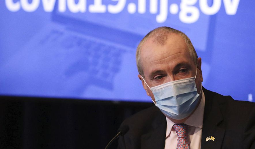 In this May 19, 2020, photo, New Jersey Gov. Phil Murphy wears a mask during his daily coronavirus news conference at the War Memorial in Trenton, N.J. A year after becoming a global epicenter of the coronavirus pandemic, New York and New Jersey are back atop the list of U.S. states with the highest rates of infection. Murphy said in recent days that he is hitting pause on further loosening of the rules because of New Jersey's resurgence. (Chris Pedota/The Record via AP, Pool) **FILE**