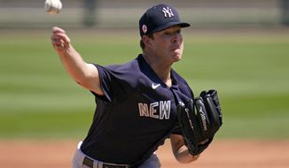 New York Yankees starting pitcher Corey Kluber delivers during the first inning of a spring training exhibition baseball game against the Detroit Tigers in Lakeland, Fla., Tuesday, March 23, 2021. (AP Photo/Gene J. Puskar)